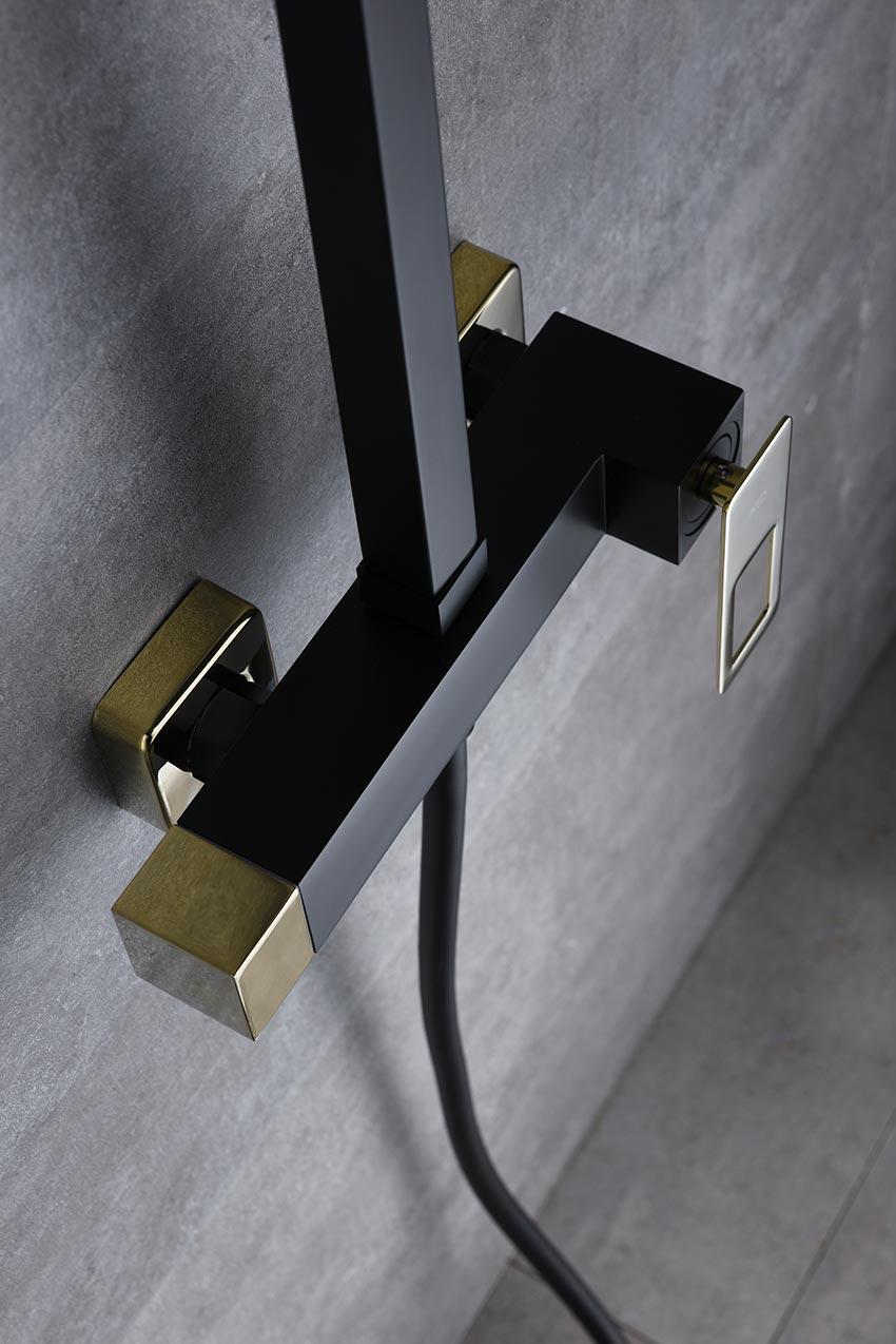 barra de ducha serie Suecia negro oro detalle