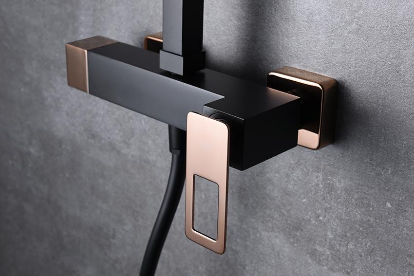 barra de ducha serie Suecia negro oro rosa detalle
