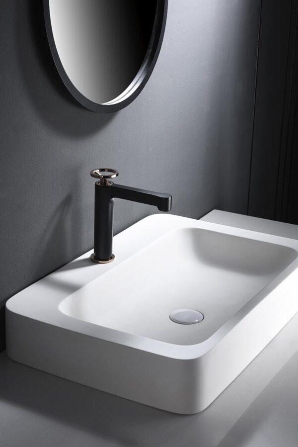 grifo lavabo serie olimpo negro oro rosa ambiente